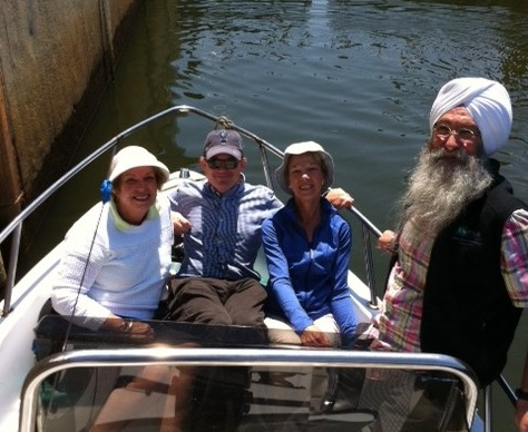Four people in a boat on the Mystic River