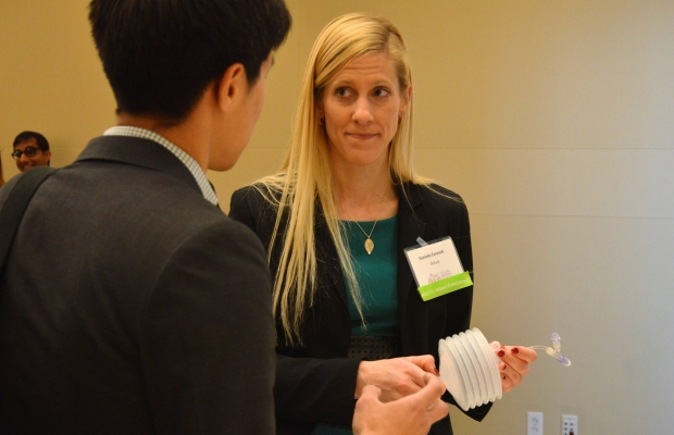 Danielle demonstrates wound pump at Impact Investing Showcase
