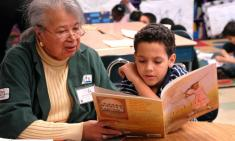 Older adult reading with child