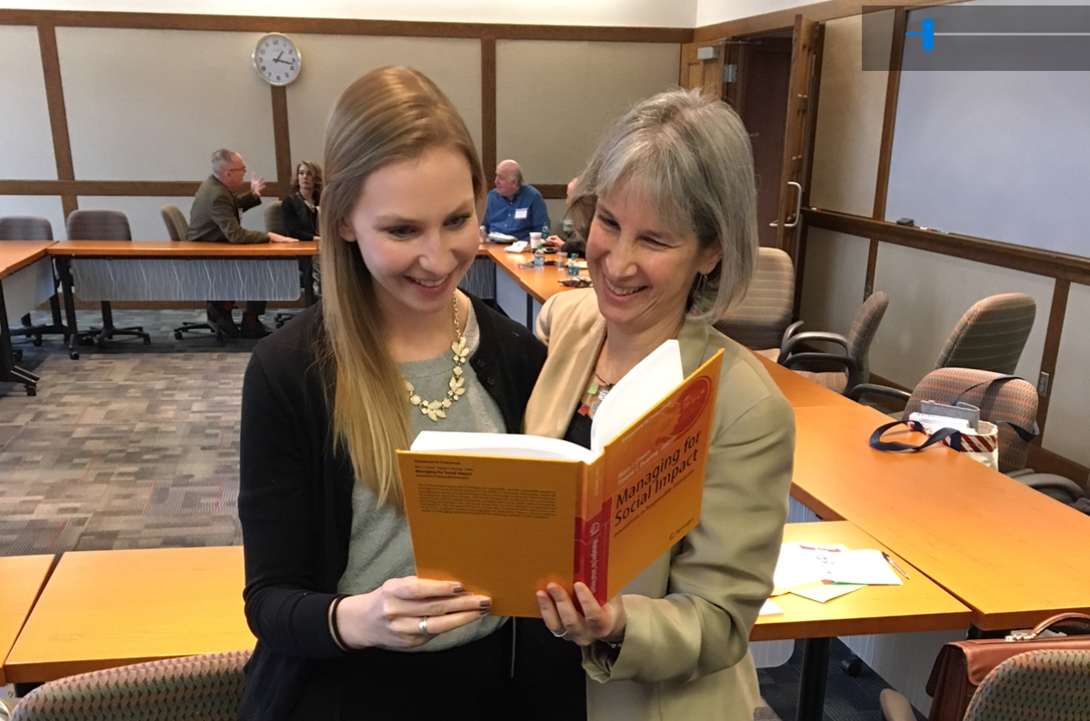Susan Musinsky and Anna Trieschmann reading Managing for Social Impact
